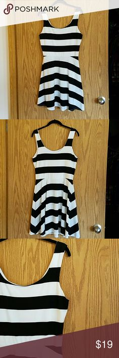 Black & White Stripe Jersey Tank Dress Gently worn one time. Jersey stretch black and white stripe dress. Bust measures 17 inches across unstretched. Length is 28 inches from scoop neck to bottom.   Top is lined, skirt is not. Super comfortable and stretches to fit a size 10 and 12. Flattering fit to hide the tummy, too! Nordstrom rack Dresses