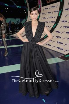 Sofia Carson featuring a black deep v-neck ball gown with ruffle attended the 2017 MTV Video Music Awards at The Forum on August 27, 2017 in Inglewood, California.