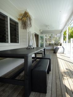 crisp and clean colouring, great weathered timber decking and seating nook
