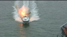 Small craft acting as a torpedo on a large Naval vessel replicates a hit during a force protection drill.