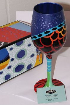 Hand painted wine glass.  I love the design mix.