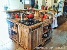 recycled pallet kitchen island with stove--add a sink and water tank, and it would be a portable outdoor kitchen.
