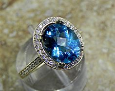 AAA London Blue Topaz 10x8mm 3.16 Carats in a 14k Yellow gold ring with diamonds (.32ct) Ring 1815