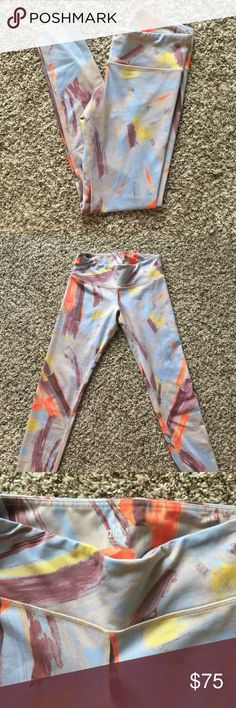Alo colorful leggings In great condition. The pattern is like paint brush strokes - purple, yellow, orange/pink color on blue. ALO Yoga Pants Leggings