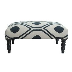 Ottoman with diamond-patterned upholstery and turned legs.   Product: OttomanConstruction Material: Cotton and woodColor: White and blueFeatures:  HandmadeMade in India Dimensions: 16'' H x 36'' W x 24'' D