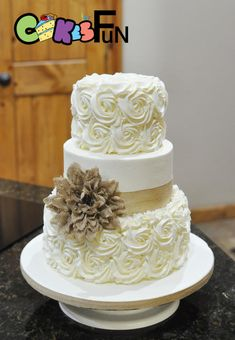 Buttercream rosettes with burlap by Cakes For Fun - http://cakesdecor.com/cakes/305651-buttercream-rosettes-with-burlap