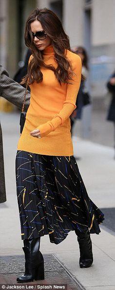 Victoria Beckham looks gorgeous in bright orange slim-fitting knit