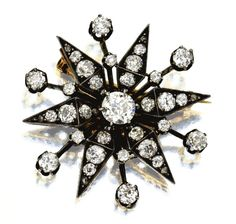 Brooch designed as a starburst set with old-mine and rose-cut diamonds weighing approximately 4.00 carats, mounted in gold and silver, circa 1880.