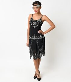 This is a DIVINE flapper style dress for your consideration! It has a jet black color with generous silver deco style be...Price - $180.00-pKJTNRUy