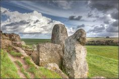 West Kennet Longbarrow, Wiltshire - One of the most famous Neolithic tombs. People of period were f1st to create large communal burial places. Ritual involved interring items: pottery vessels, human skulls, polished stone axeheads along with the bodies. Archaeologists believe these tombs built by farmers was a way to claim the land as their own. You could stand upright in tomb's passage, chambers much smaller. When tombs were closed people put huge 'blocking stones' which barred entrance.
