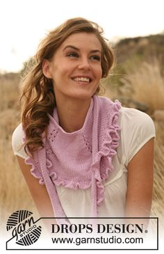 "Knitted DROPS shawl with flounce in ""Merino Extra Fine""."