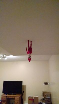 A little Christmas magic for our elf on the shelf. He is walking on the ceiling.