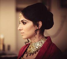 Heavy kundan jewellery for Bride Ambira Kumar of WeddingSutra. Photo Courtesy - Manas Saran