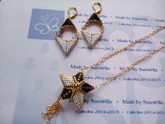2014/046 - Parure Pendentif + Chaine + Boucle d'oreille - style etoile 3D et fleche - tissage peyote - perle en doré noir et blanc : Parure par sanorelia