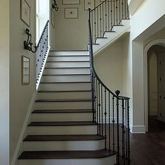 Love the dark wood that matches the floor. Iron rails are nice too