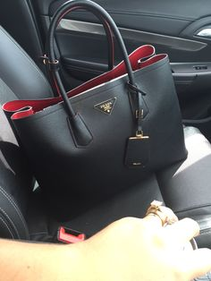 My double colour Prada bag in black and red