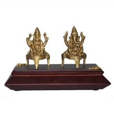 This Ginnie & Ginnie Exclusive Laxmi Ganesh Kamal Large with MDF base is a product from our Statue & Sculptures Collection. It is made of Brass and it got Brass finish on it. Its approx LxWxH is 2.5x1.5x3 inches. It is of approx 460 grams. Unique Code of this product is M400343.03