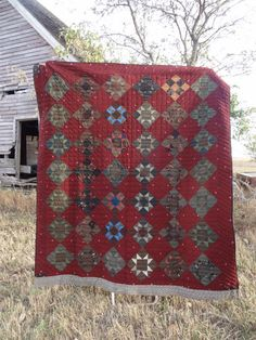 $599 on etsy.com  HandStitched Star Block Quilt in Barn Red with Primitive Fabrics