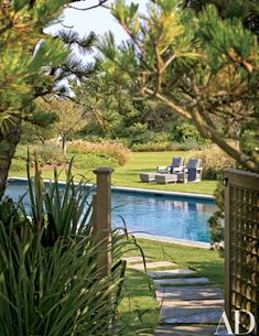"""""""The idea was to keep the pool fairly close to the house but out of the primary sight line to the ocean. It's on the side of the house, in a lovely garden bordered with blue hydrangea and other deciduous shrubs and perennials. Beyond the pool, we left a large area open so that a tent could be put up for parties,"""" Hayes says 