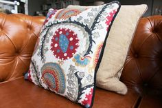 Embroidered Red/Blue Cushion - WARINGS Store  www.waringsathome.co.uk