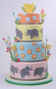 I love that the colors on this cake are so muted.  This cake wouldn't be as wonderful if done in all primary colors.