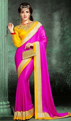 Magenta satin and chiffon saree adds charm and grace to your beauty as sari is beautified with thick woven lace with contrast yellow border which gives you an alluring look. Sari pairs with contrast yellow raw silk stitched blouse as shown in the picture. #IndianSareeDesigns #IndianDesignerSarees