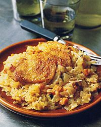 BRAISED CHICKEN THIGHS WITH SAUERKRAUT:  Sauerkraut simmered with vegetables, apple, and juniper berries is a perfect match for bacon and chicken thighs. The robust combination of flavors makes this a great hearty winter dish.                   Braised Chicken Thighs with Sauerkraut