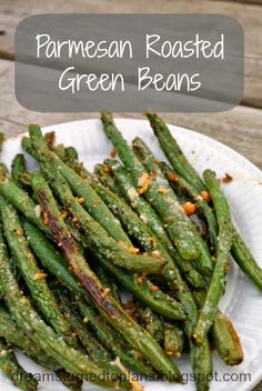 Parmesan Roasted Green Beans. (replace with reg. salt and pepper) 400 degrees 15 minutes.garlic salt, hot pepper, parmesan cheese, olive oil