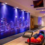 Imagine the satisfaction of cruising down your private elevator with your guests and (ding!) the door opens on the lowest level to reveal this. The state-of-the-art bowling alley comes complete with bowling balls, shoes and monitors. The night is made.