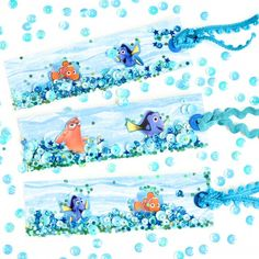 DIY Finding Dory Shaker Bookmarks filled with glitter & sequins. Great for summer reading!