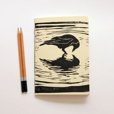 Black Crow - Linoleum Block Printed & Hand Bound Notebook. $12.00, via Etsy.