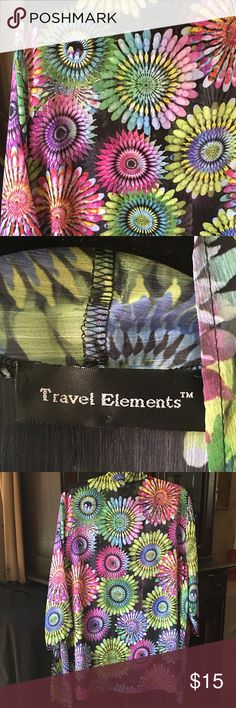 Sheer Jazzy Jacket Jewel-tone bursts of color dance on this black background. Simple lines allow the rainbow colors to be the focus. Sheer fabric makes this easy to wear over tanks for light cover-up. Love the colors!!! 😀 Travel Elements Tops