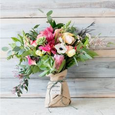 """Burlap Wrapped Bouquet"" - Brought to you by Farmgirl Flowers in San Francisco! A beautiful, American-grown, hand-tied bouquet wrapped in 100% biodegradeable reused coffee bags, donated by local coffee roasters."