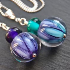 Lampwork glass and sterling silver 'Groovy' necklaces by Laura Sparling See this Instagram photo by @beadsbylaura • 83 likes