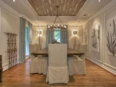 The planked ceiling with rustic chandelier (I would prefer the antler chandelier, though)
