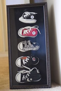 Super cute way to keep and display your kid's outgrown baby shoes. I much prefer this to bronzing them!