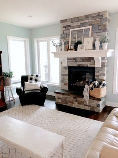 Jan 2019 - Farmhouse style living room with chunky white custom mantel and stone surround. Wall paint color in Palladian Blue by Benjamin Moore. Farmhouse Mantel Decor – Valley + Birch Living Room Remodel, Living Room Paint, Living Room With Fireplace, Living Room Decor, Kitchen Remodel, Living Rooms, Living Spaces, Farmhouse Mantel, Country Farmhouse Decor