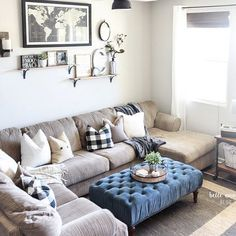 fun decor behind the sofa! clock, big map, shelves of flowers and photos..... would be awesome behind our sofa!
