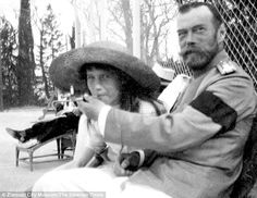 Newly-discovered pictures show Nicholas II with his 15-year-old daughter Anastasia in Mogilyov, apparently teaching her to smoke