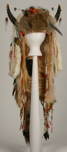 Native American horned fur and feather head dress