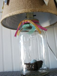 """DIY :: How to make a {MASON} JAR LAMP! (SUPER easy!) :: Had her husband drill 2 holes in the lid of a 12"""" jar for the wire. Bought a lamp kit at the hardware store (Home Depot/Lowes...) & strung it thru the holes. Good pix. All from a flea market lamp!"""