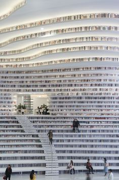 Tianjin Binhai Library in China incorporates bookshelves into the stairs and seating to encourage reading and exploration. Library Wall, Dream Library, Library Design, Library Books, Photo Library, Modern Library, Tianjin, In China, Library Architecture