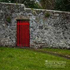 A red gate accessorizes a carefully hewn stone wall at the Coole Park Estate of Lady Gregory, the Irish dramatist and folklorist who opened her home and spectacular parklands in County Galway, Ireland, to luminaries of the Irish Literary Revival of the 20th Century. http://www.jamesatruett.com