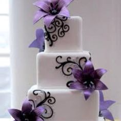 Simple square wedding cake with purple flowers.  I love this!!!!!