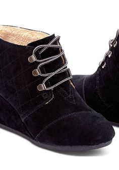 Fashioned with water-resistant suede and a faux shearling lining, these wedges will keep you warm and stylish.