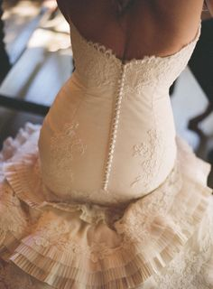 gorgeous, I've always liked buttons on a wedding dress.