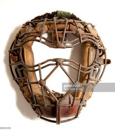 Vintage Baseball Catcher's Mask. Early 1920's catcher's mask features unique beaded welds with goggle eyes and classic spitter design.