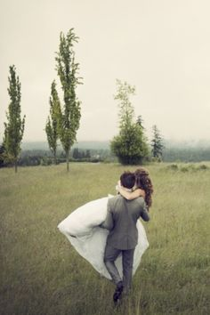 what a romantic photo of the wedding couple in a field. awesome