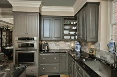 I REALLY love this.  I hate that I like the dark colors so much, but it's really what I prefer.  I love these grey cabinets with the black granite countertops.