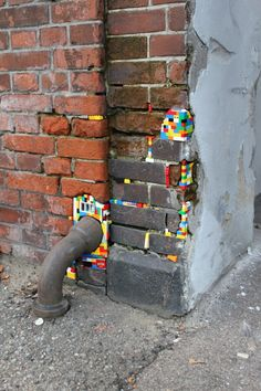 German artist Jan Vormann travels around the world and restores crumbling architecture using LEGO blocks. In his work titled Dispatchwork, Vormann has spent three years filling in the cracks of buildings with colorful LEGO pieces. Kintsugi, Aarhus, Lego Wall, Make Do And Mend, Amazing Street Art, Creation Deco, Public Art, Urban Art, Installation Art
